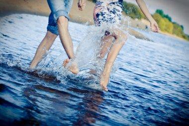 Couple splashing at the beach