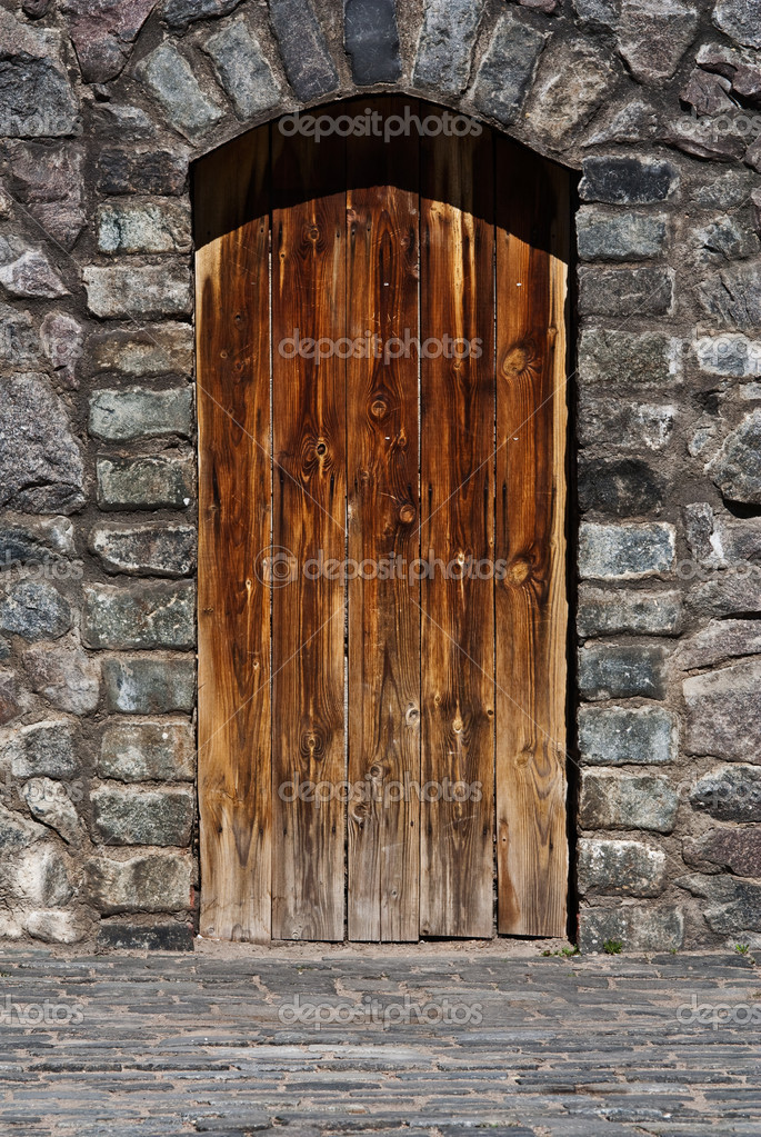 Wooden door on stone wall stock photo mrtwister 1463453 for Door of stone