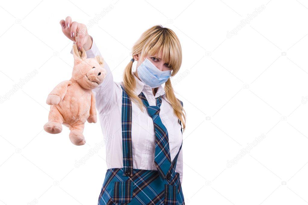 Pig flu virus.Schoolgirl with mask is af