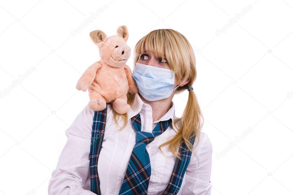Pig flu virus.Schoolgirl with mask