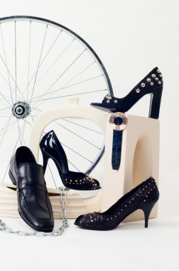 Conceptual still-life with shoes and whe