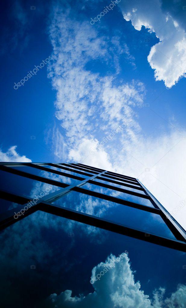 Skyscraper reflecting clouds