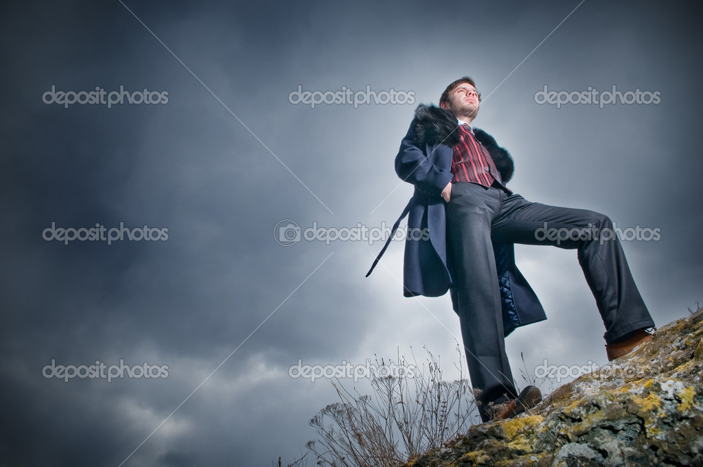 Stylish man over sky background