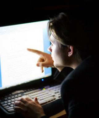 Man in front of computer screen