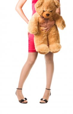 Teenager girl holding toy bear