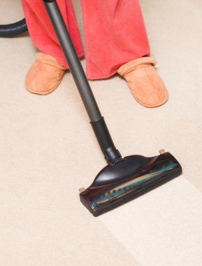 Housewife vacuum a carpet