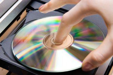 Insert CD into player