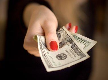 Woman hand giving money