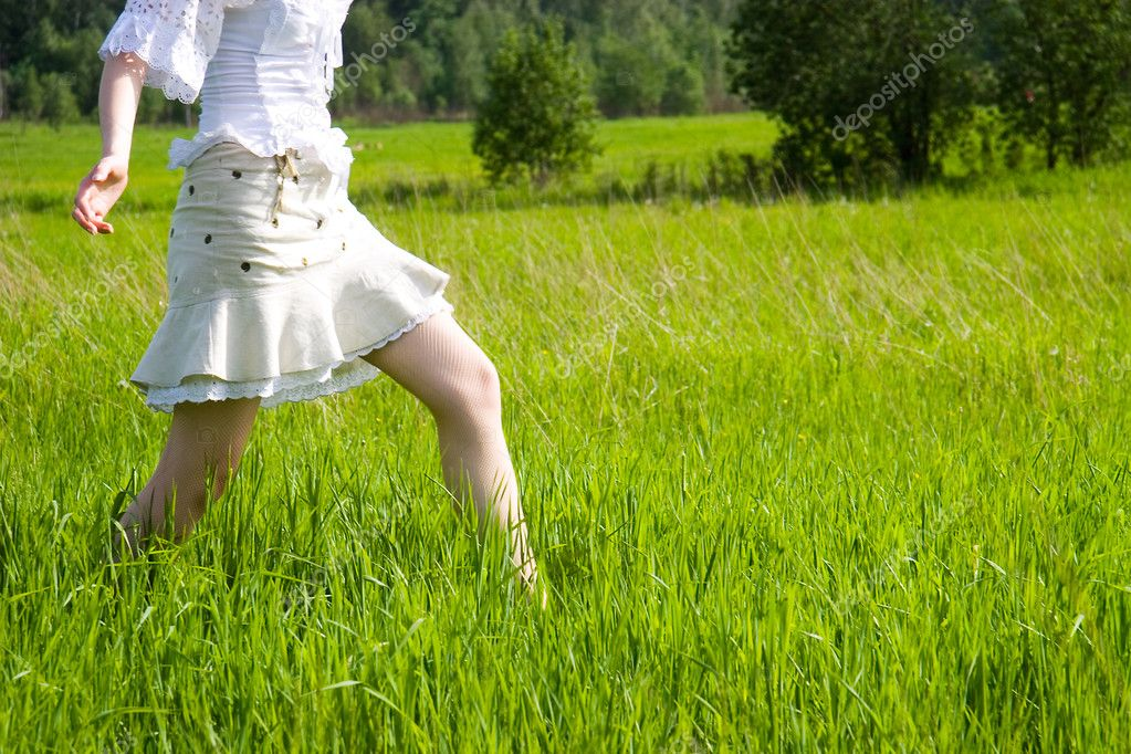 Girl walking on a field