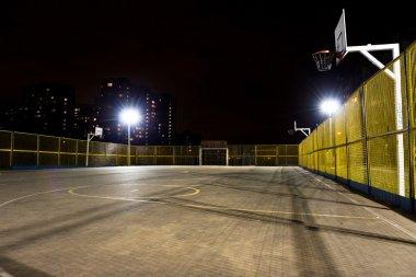 Sport basketball court at night