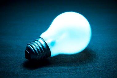 Glowing light bulb on a dark background