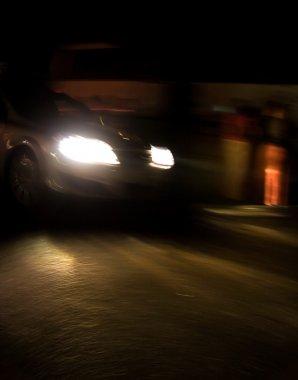 Fast moving car at night
