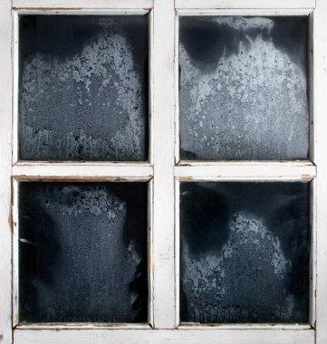 Window frame with frozen glass