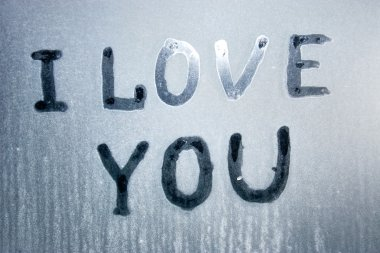 I love you text on frozen glass