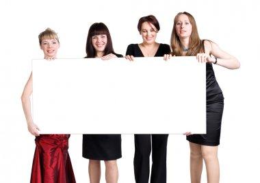 Four women holding blank white poster