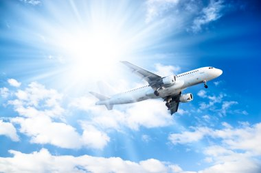 Airplane on blue sky background