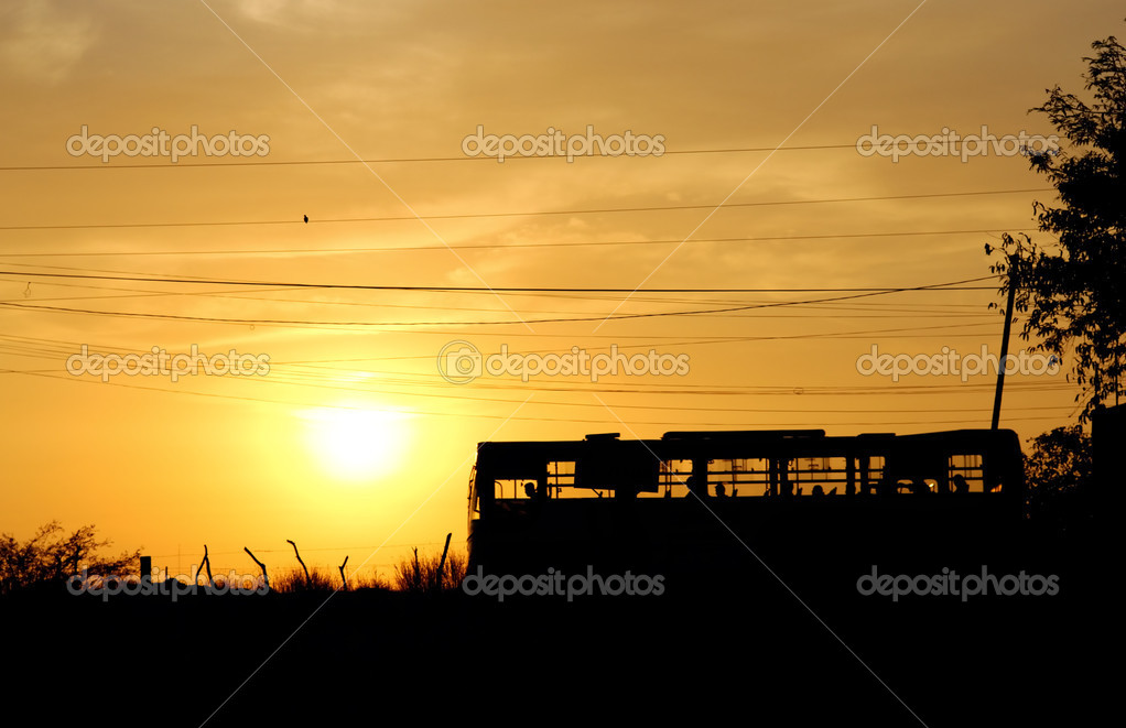 Last bus on a sunset