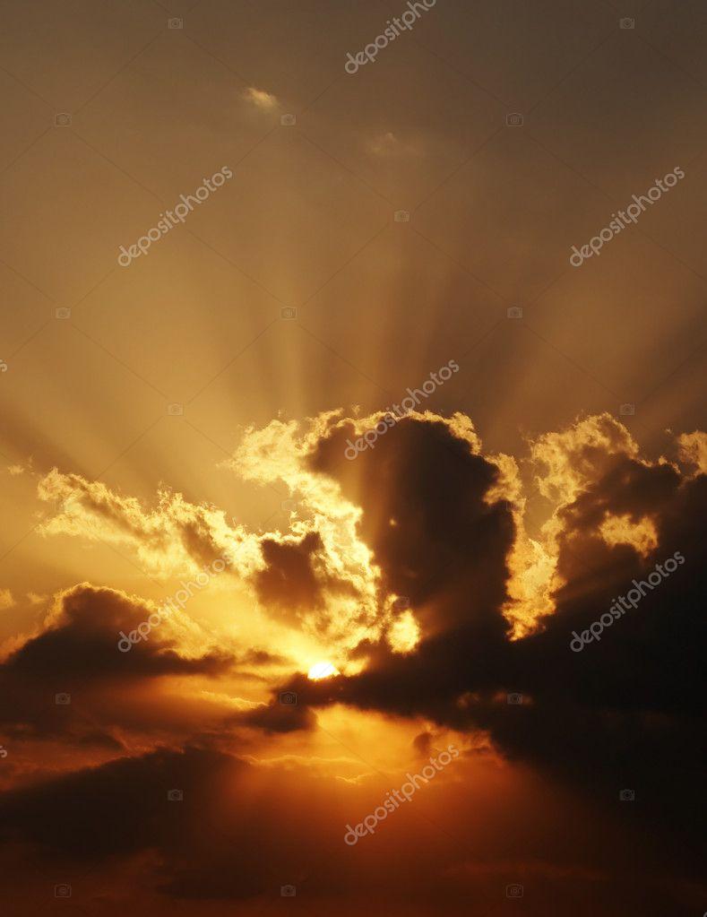 Dramatic sundown scene with dark clouds