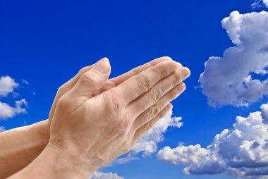 Hands on background sky.