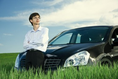 Successful businessman with car