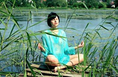 Sexy brunette meditates