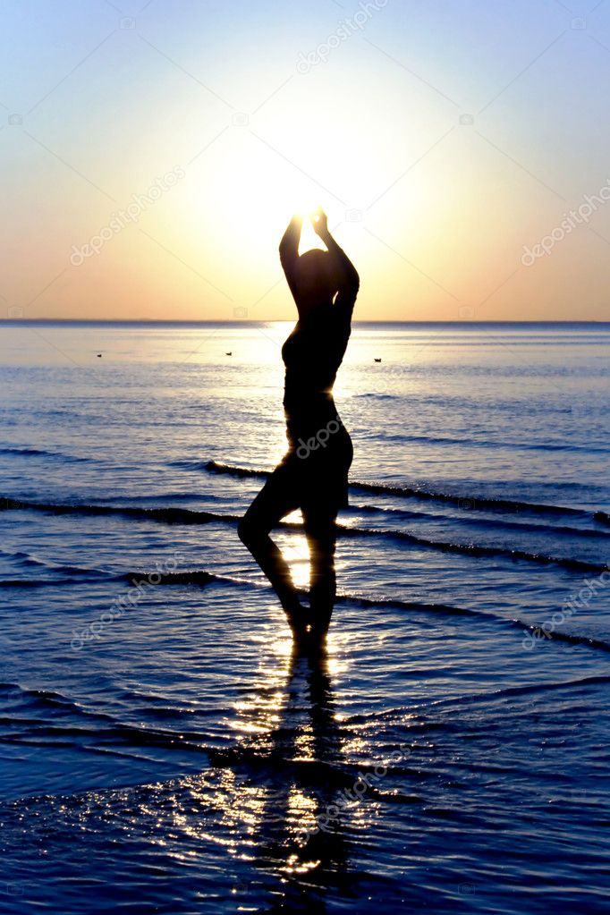 Silhouette of a woman in the sea
