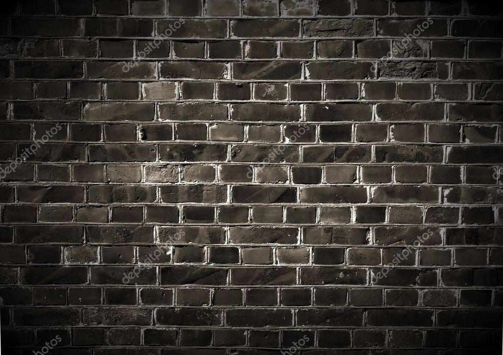 A dark brick wall background  Photo by Digifuture