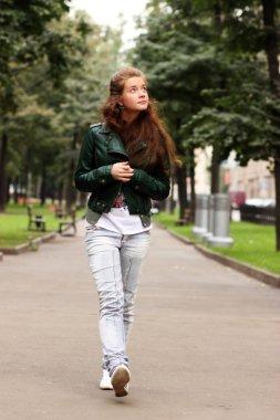 Walking woman in blue jeans