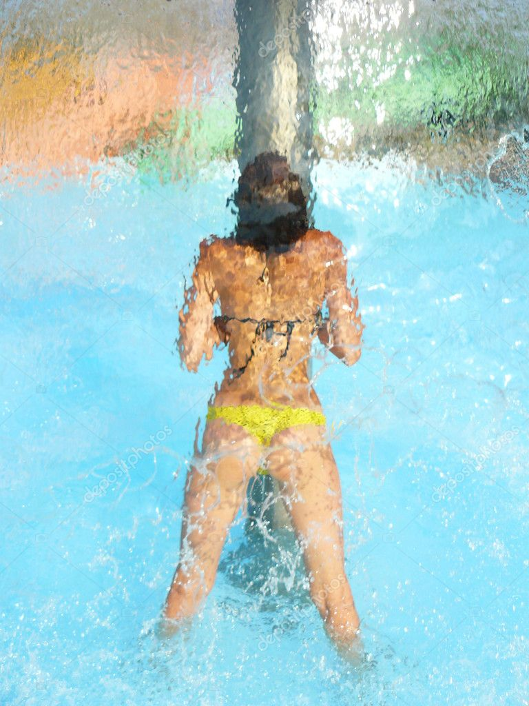 Girl under water falls