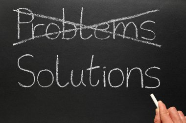 Crossing out problems and writing solutions on a