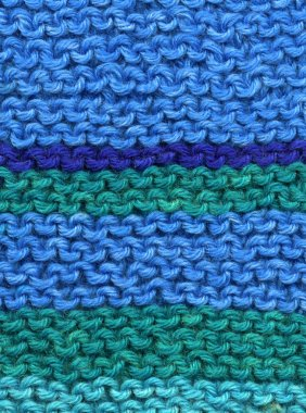 Knitted blue and green wool.