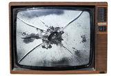 egy régi szemét tv egy összetört képernyő.