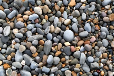 Close up of colorful stones on a beach.