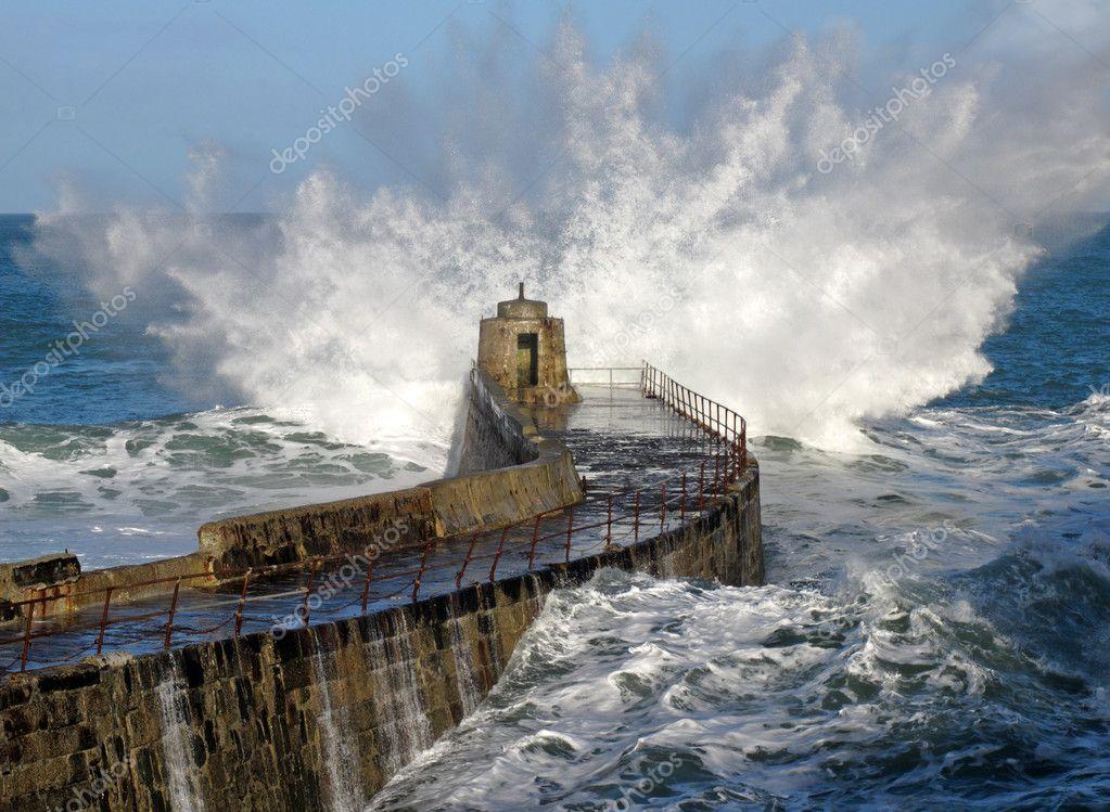 Big wave splash on Portreath pier.