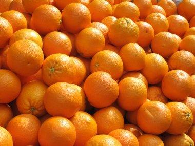 Lots of fresh oranges fruit close up.