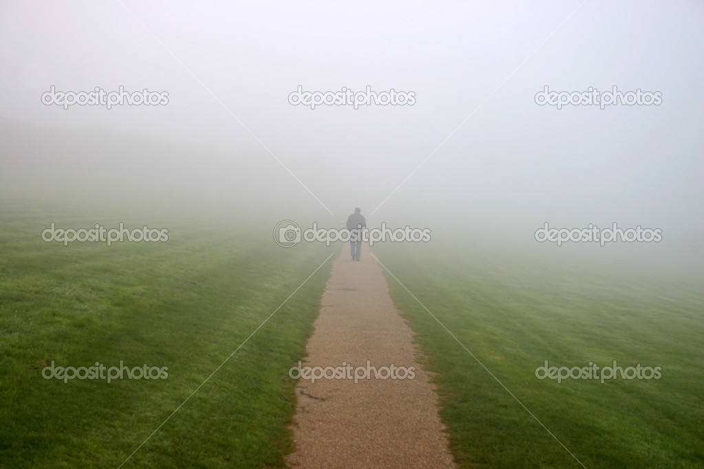 A man walking in to the mist