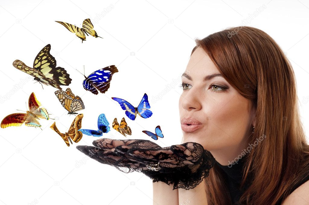 Woman with flying butterflies.