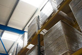 Photo Pallets with cartons in warehouse