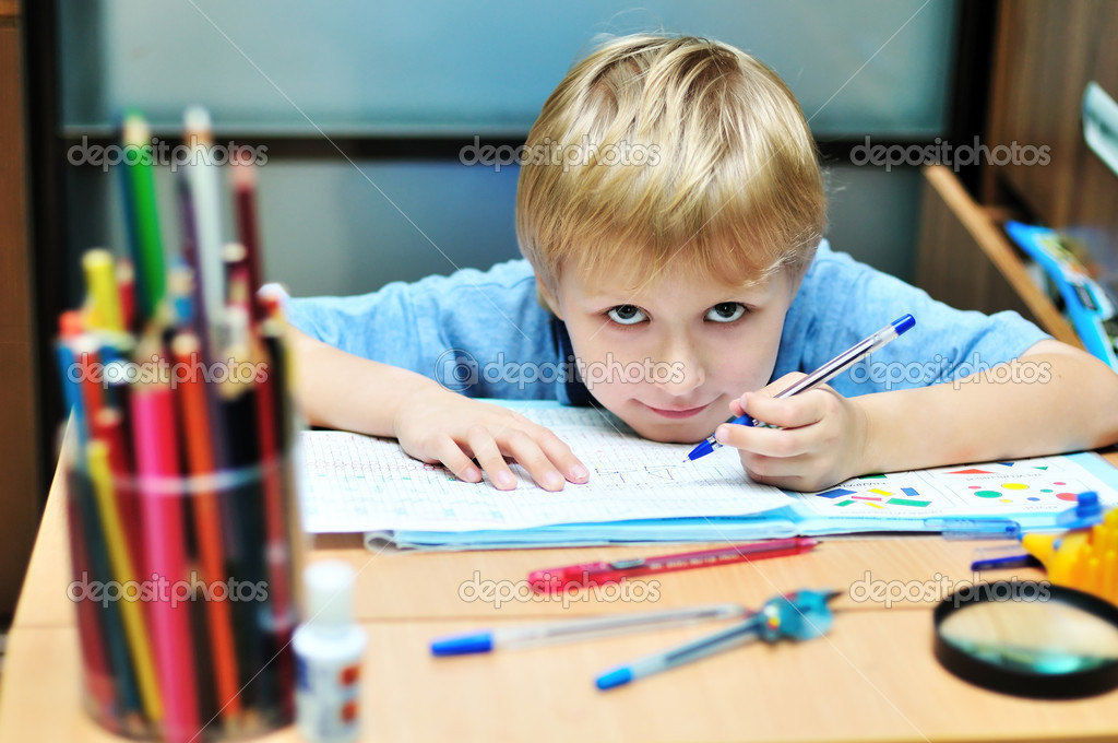 Eft-handed boy doing a home task in own room