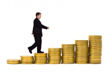 Businessman on money staircase