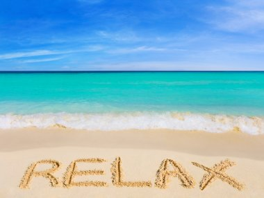 Word Relax on beach - vacation concept background stock vector