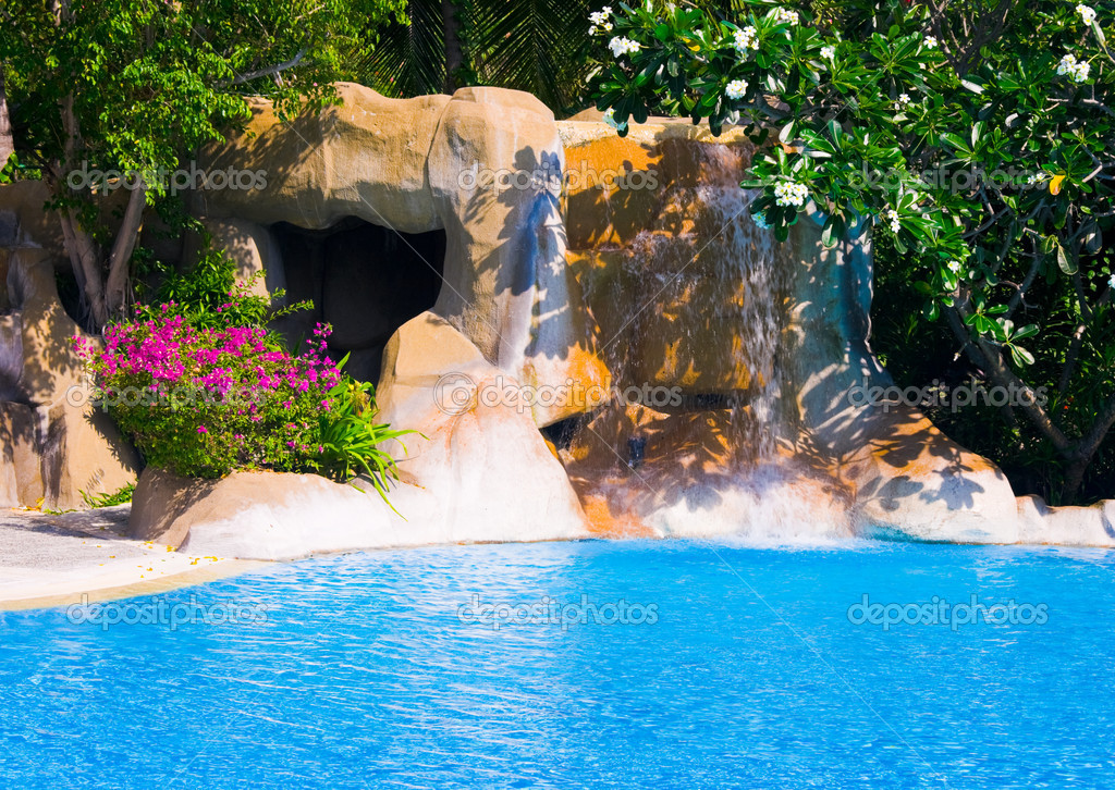 Pool and waterfall in hotel