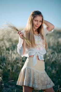 Rural girl with buch of feather grass
