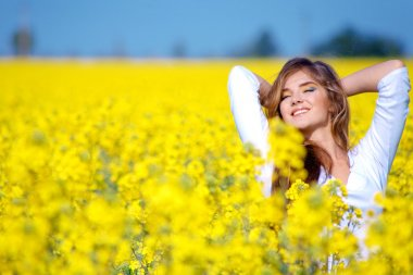 Girl relaxing in field of flowers