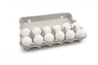 Twelve eggs in a paper box isolated