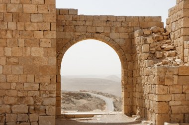 Ancient stone arch and wall in desert