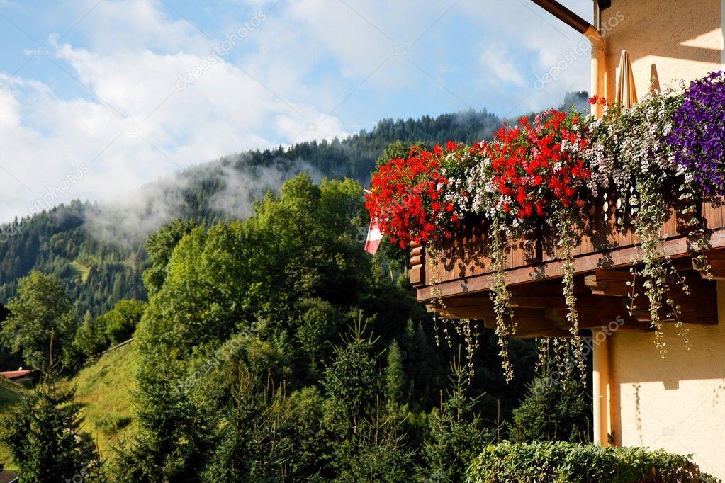 Alpine chalet balcony with flowers
