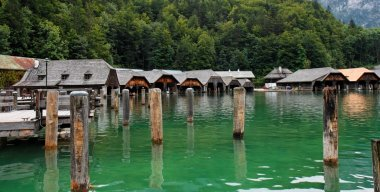 Wooden boat houses on green lake