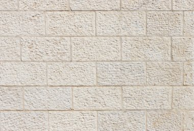 Beige rough stone wall texture