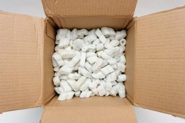A cardboard box with packing foam pellets top view stock vector